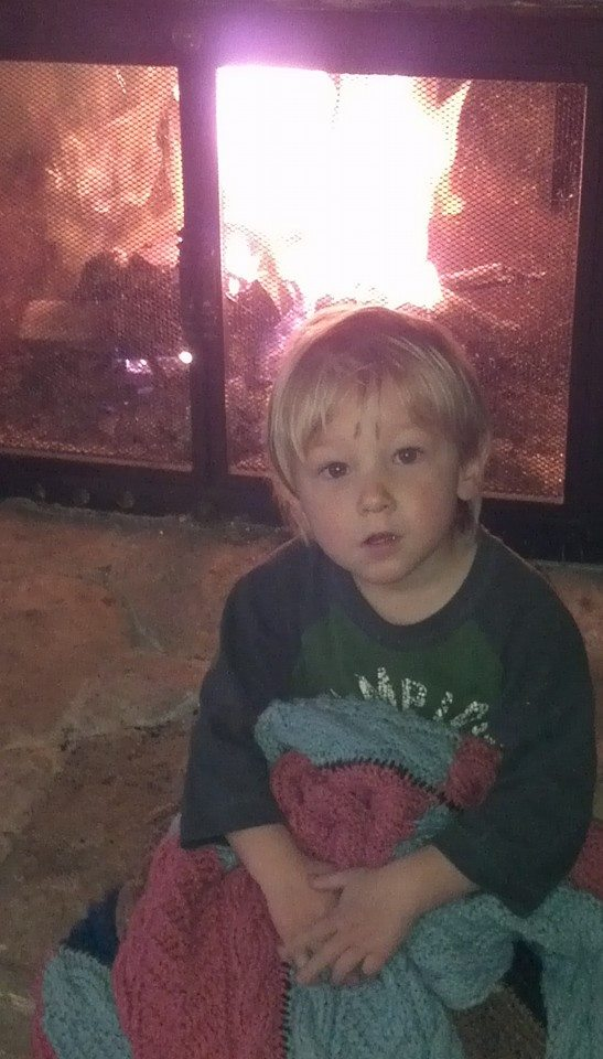 Julian next to the fireplace